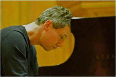 Pianist Mark Valenti performs at the Oak Park Arms Retirement Community